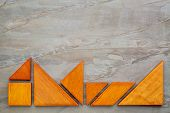 foto of tangram  - seven tangram wooden pieces - JPG