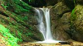 foto of ravines  - Waterfall from ravine whit green moss Waterfall - JPG