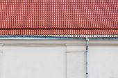 foto of downspouts  - Metal rain gutter and downspout on a old house - JPG