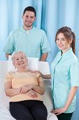 stock photo of geriatric  - Smiling students of physiotherapist and geriatric patient