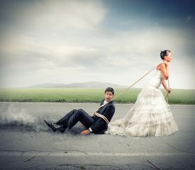stock photo of runaway  - Funny concept of bound and trapped by marriage - JPG