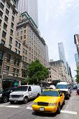 foto of cabs  - New York city Manhattan Fifth Avenue 5th Av yellow taxi cab US - JPG