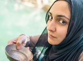 picture of middle eastern culture  - Arabic Muslim Middle Eastern girl drinking clean water on the river spring - JPG