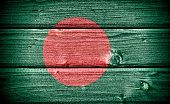 stock photo of bangla  - Flag of Bangladesh painted on old grungy wooden background - JPG