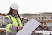 stock photo of inspection  - Civil Engineer at at construction site is inspecting ongoing production according to design drawings.