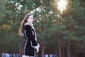 foto of long distance  - Beautiful young girl with long hair standing in the forest and looking distance - JPG