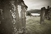 picture of graveyard  - Scottish graveyard and Loch Ness in sepia tone - JPG