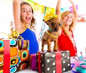 pic of dog birthday  - girl friends party dancing with presents and puppy chihuahua dog in birthday - JPG