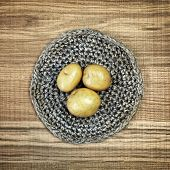 stock photo of doilies  - Beautiful decoration with fresh potatoes on linen doily - JPG