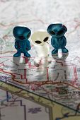 picture of united we stand  - toy ETs standing on a Map of the United States with the words Nevada test Site on the map - JPG