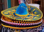 stock photo of mexican fiesta  - Horizontal closeup photo of details of Mexican sombrero hat