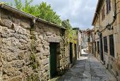 foto of minos  - Narrow street in the old center of Tui a border town with Portugal in the region of Galicia Spain - JPG