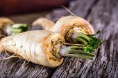 pic of parsnips  - Fresh parsnip on old wooden table - JPG