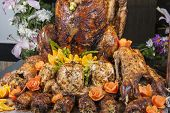 foto of roast duck  - Closeup of roasted turkey and duck on display at a restaurant buffet carvery - JPG