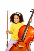 picture of cello  - Cheerful African girl holding cello with fiddlestick ready to play standing on the white background - JPG
