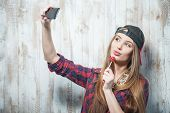 stock photo of lollipops  - Waist up portrait of beautiful hipster girl with - JPG