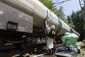 picture of decontamination  - A team working with toxic acids and chemicals is securing a chemical cargo train tanks crashed near Sofia Bulgaria - JPG