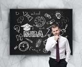 picture of degree  - Senior manager is thinking about getting of the business degree - JPG