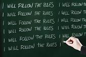 foto of punishment  - I will follow the rules sentence written repeatedly on blackboard as a punishment - JPG