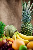 stock photo of exotic_food  - Fruit variety on wood. Tropical exotic food concept.