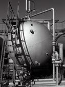 stock photo of lng  - old tank and rusty ladder on the gas - JPG