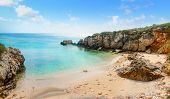 pic of shoreline  - a cloudy sky over Alghero shoreline Sardinia - JPG