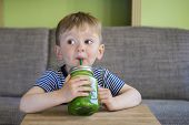 pic of smoothies  - Cute little boy drinking a green smoothie - JPG