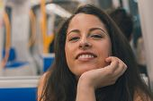 picture of curvy  - Beautiful young curvy girl in tank top posing in a metro car - JPG