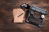 stock photo of typewriter  - Old retro typewriter on table close - JPG