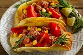 foto of tacos  - Mexican food Tacos in plate on wooden table - JPG