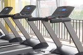 stock photo of treadmill  - image of treadmills in a fitness hall - JPG