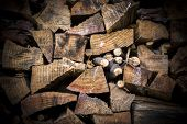 foto of lumber  - Lumber of various sizes stacked as a spare for the winter - JPG