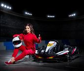 stock photo of armored car  - Young girl karting racer at stadium - JPG