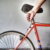 foto of dirt-bike  - man repairing a mountain bike in a workshop - JPG