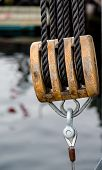 image of  rig  - Wood rigging on an old sailboat with brown ropes - JPG