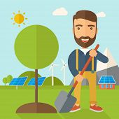 picture of shovel  - A happy gardener planting a tree using in his yard using shovel under the heat of the sun - JPG