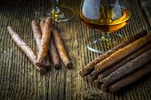 pic of cigar  - quality cigars and cognac on an old wooden table - JPG