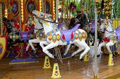 image of carnival ride  - Fairground ride a horses - JPG