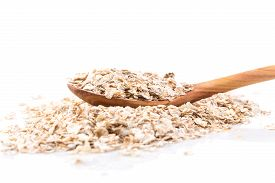 pic of whole-grain  - Whole grain rolled oats flakes with wooden spoon - JPG