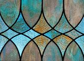 foto of stained glass  - Detail of stained glass window depicts design with three diamond - JPG