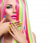 Beauty Girl Portrait with Colorful Makeup, Hair and Nail polish. Colourful Studio Shot of Woman face poster