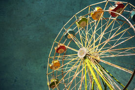 picture of ferris-wheel  - View of a carnival ferris wheel textured for a grunge effect - JPG