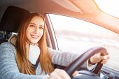 Young Woman Drive A Car In Winter poster