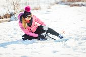 Woman falling while doing cross country skiing as a sport poster