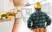 Male Contractor with Hard Hat and Tool Belt Looking At Custom Kitchen Drawing Photo Combination On W poster
