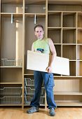 picture of assemblage  - The man is engaged in assemblage of a new wardrobe - JPG