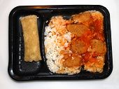 foto of frozen tv dinner  - Sweet sour chicken tv dinner with rice and chicken egg roll  - JPG