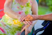 Holding Hand Supporting For Vitality Of Handicapped Pensioner. poster