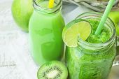 Glass Mason Jar And Bottle With Green Vegetable And Fruit Smoothie And Juice With Straw. Basket With poster