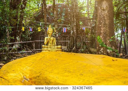 poster of Buddha Statue Beautiful On The Way Up At The Stone With The Footprint Of Lord Buddha At Khitchakut M